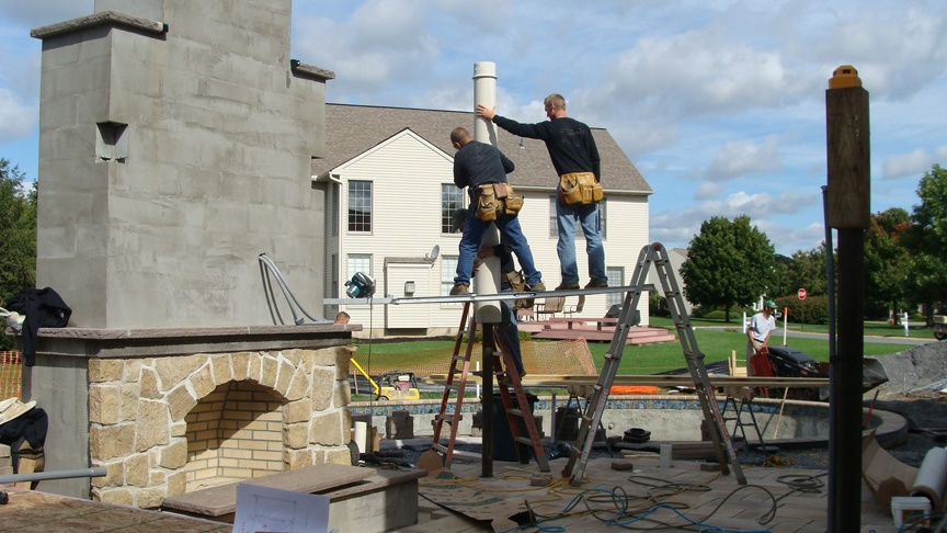 landscaping company building outdoor fireplace in Lancaster, PA