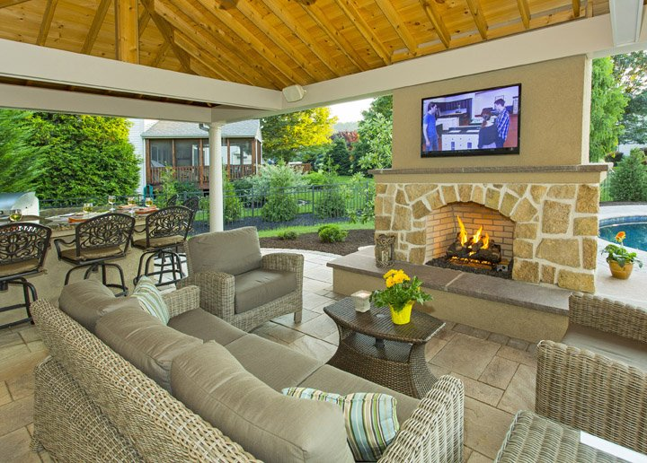 Pavilion with outdoor fireplace and TV