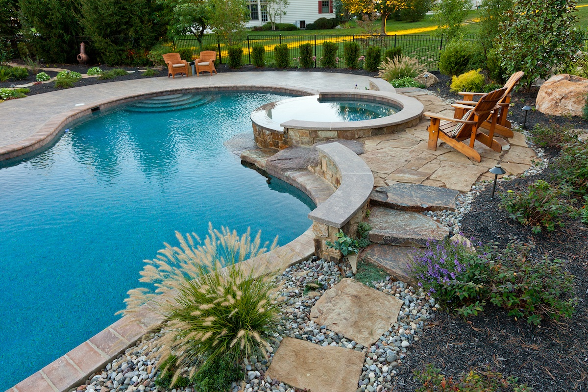low maintenance landscape and pool design with stones