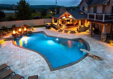 Pool patio with fire bowl and pavilion in Pennsylvania