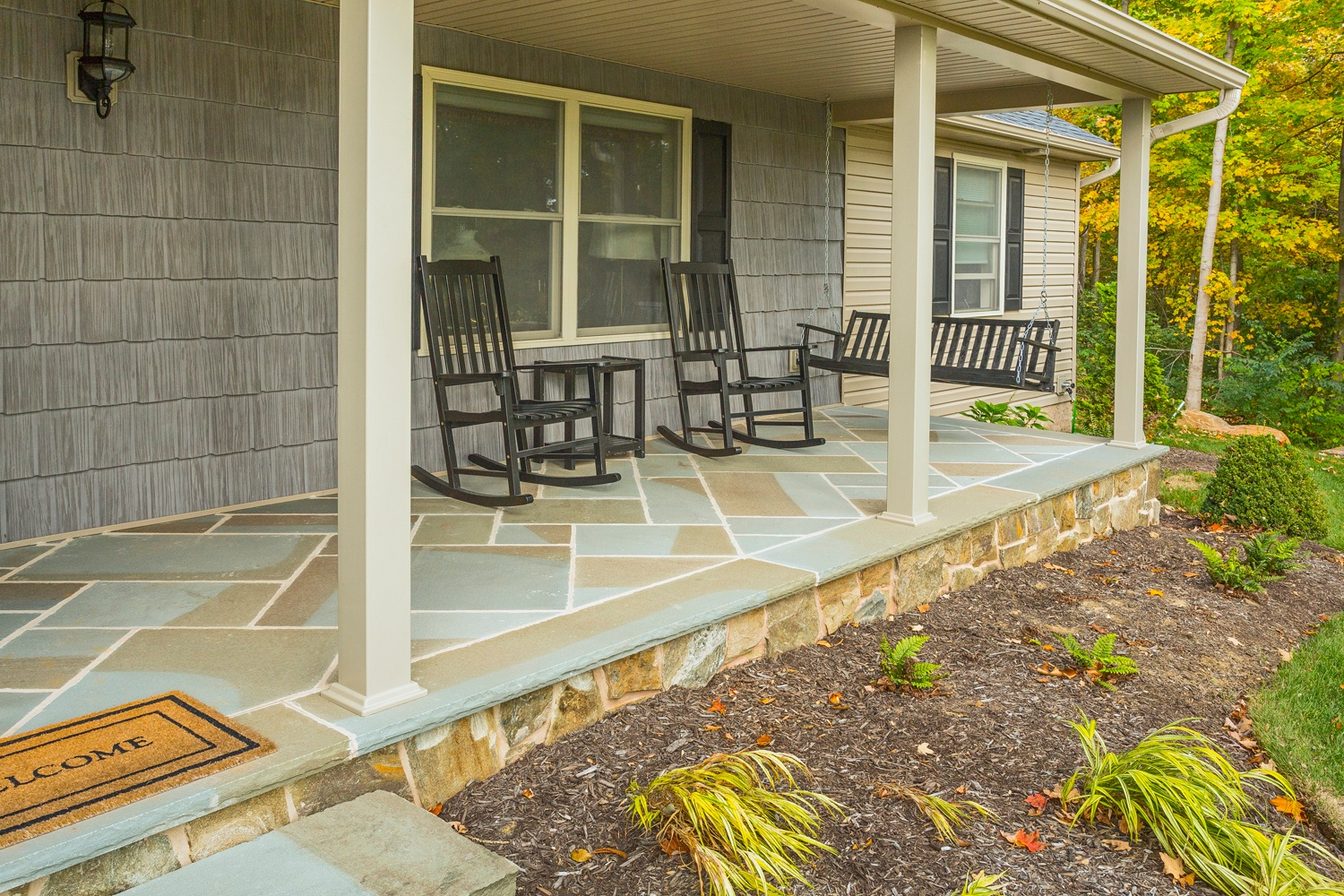 Flagstone porch with rocking chairs
