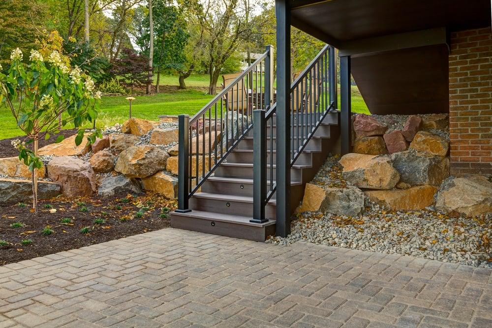 deck steps to patio built under deck