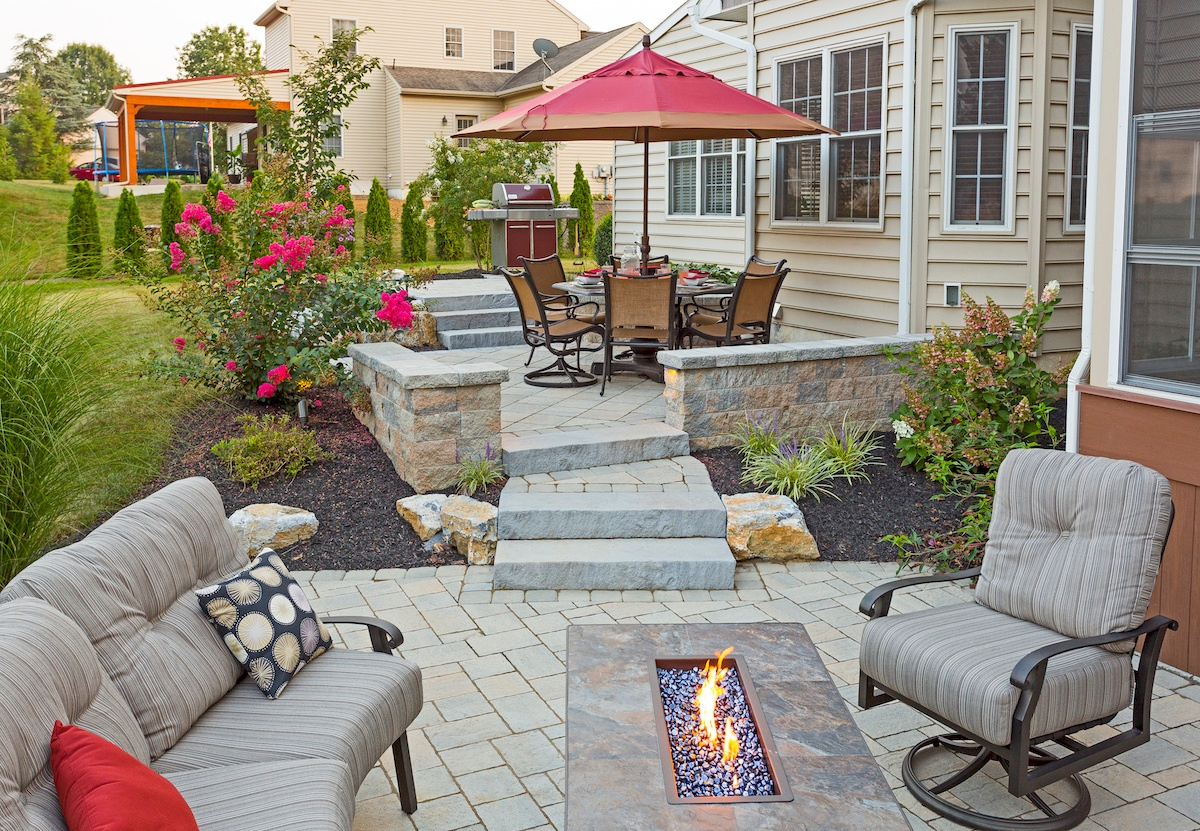 patio with steps and fire pit