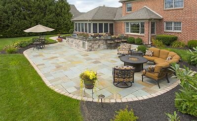 Flagstone patio, entertainment area, and outdoor kitchen in York, PA