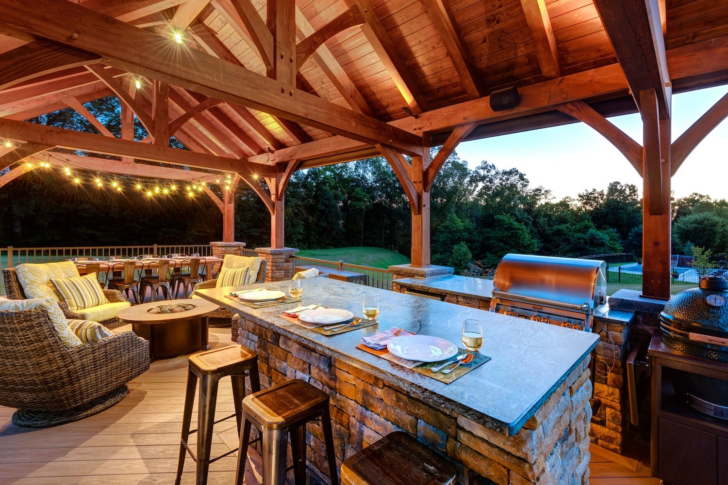 pavilion with outdoor kitchen built using landscaping phases