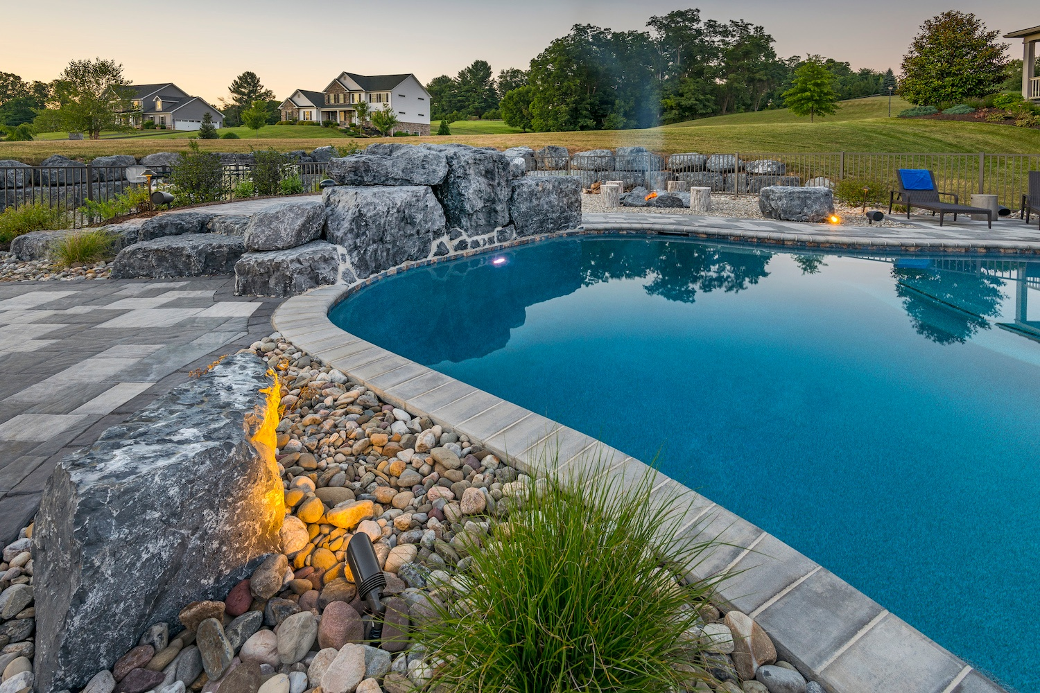 pool with jumping structure made from boulders
