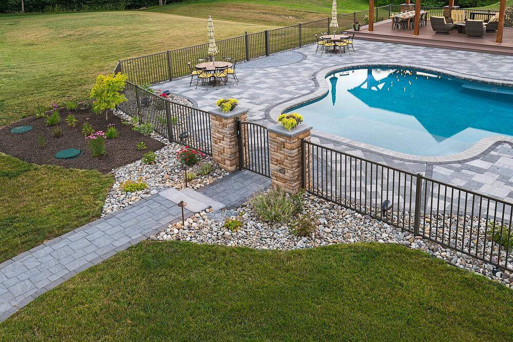 Pool patio with safety fence