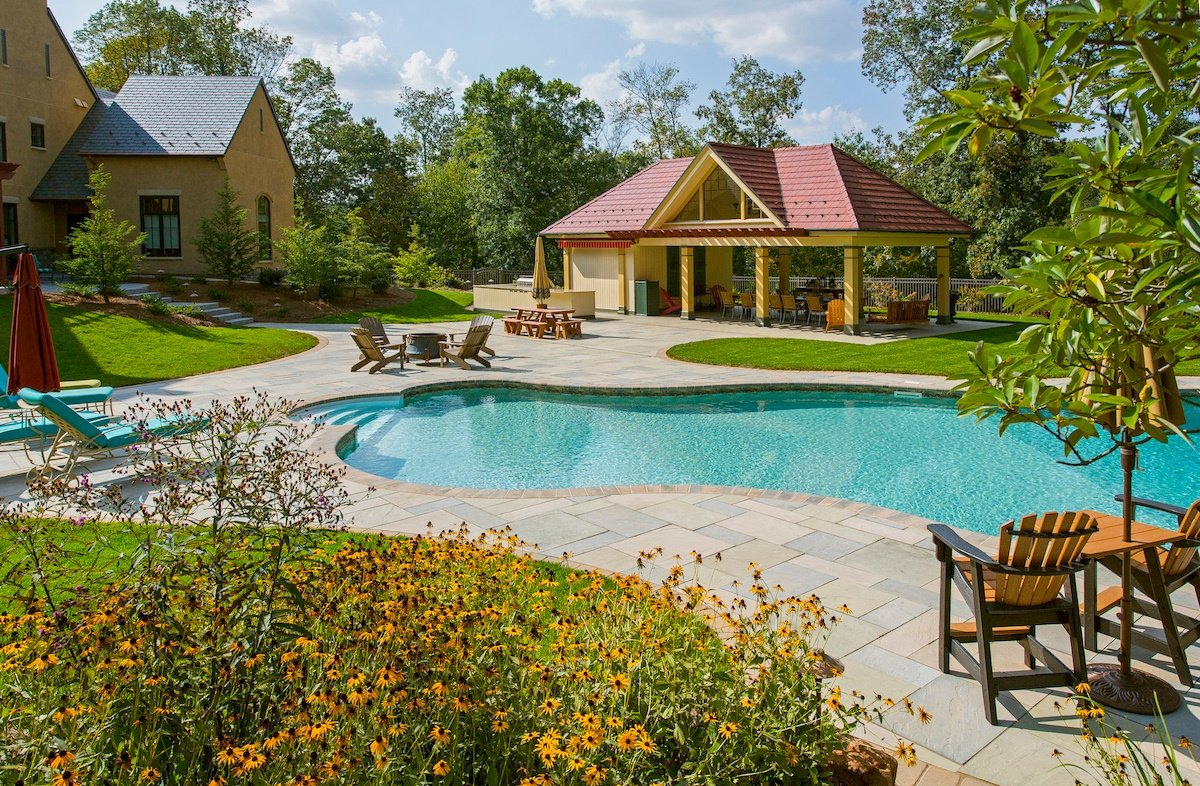 Pool and patio with plantings and privacy screening