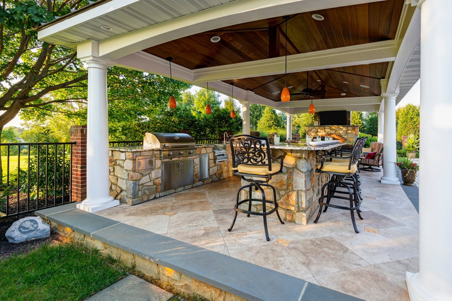 outdoor kitchen pavilion with grill and bar