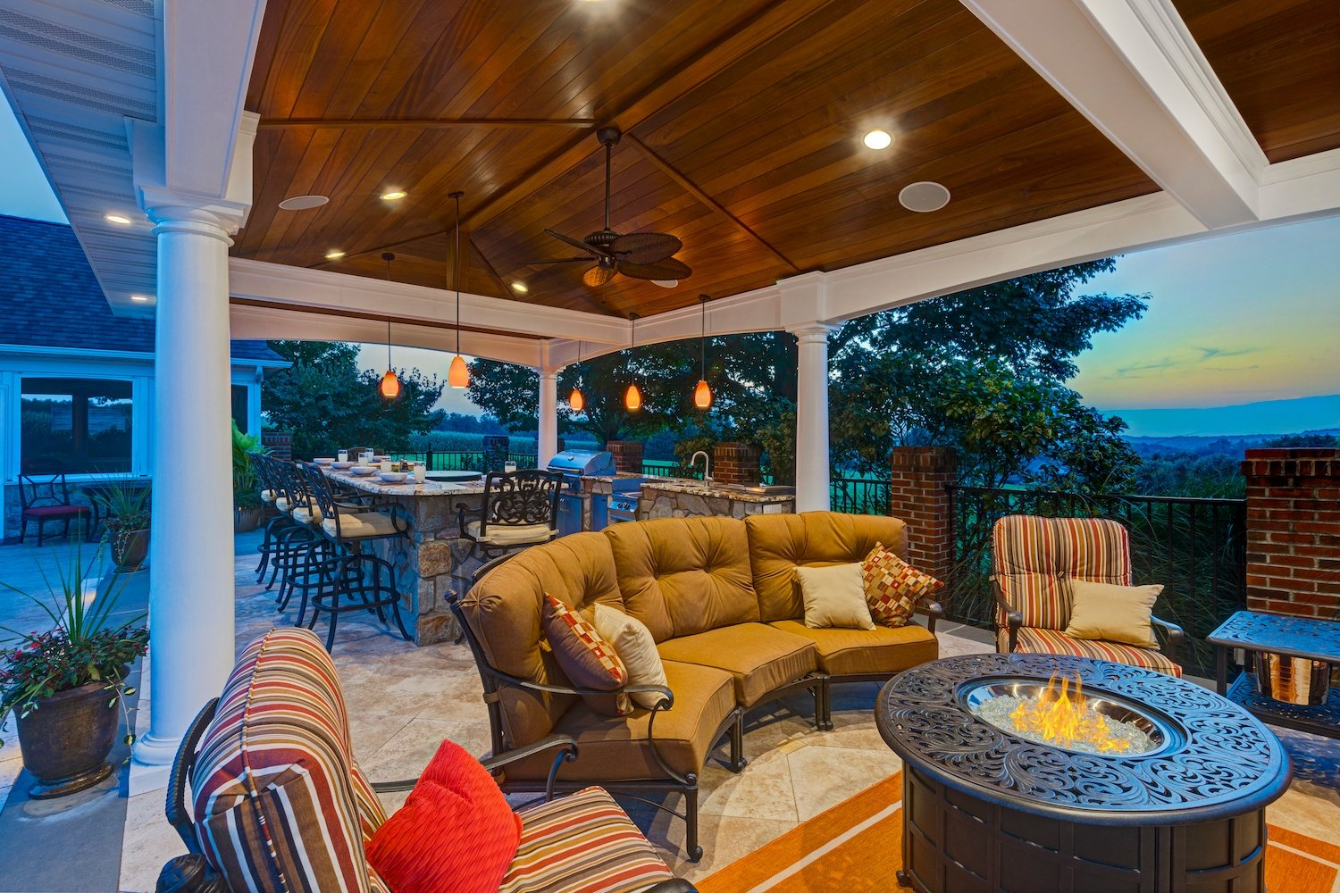 pavilion with fire pit and outdoor kitchen