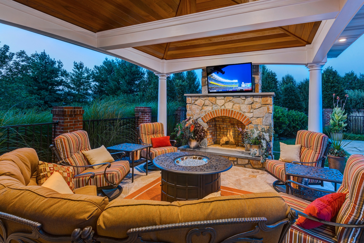 patio pavilion with outdoor fireplace and TV