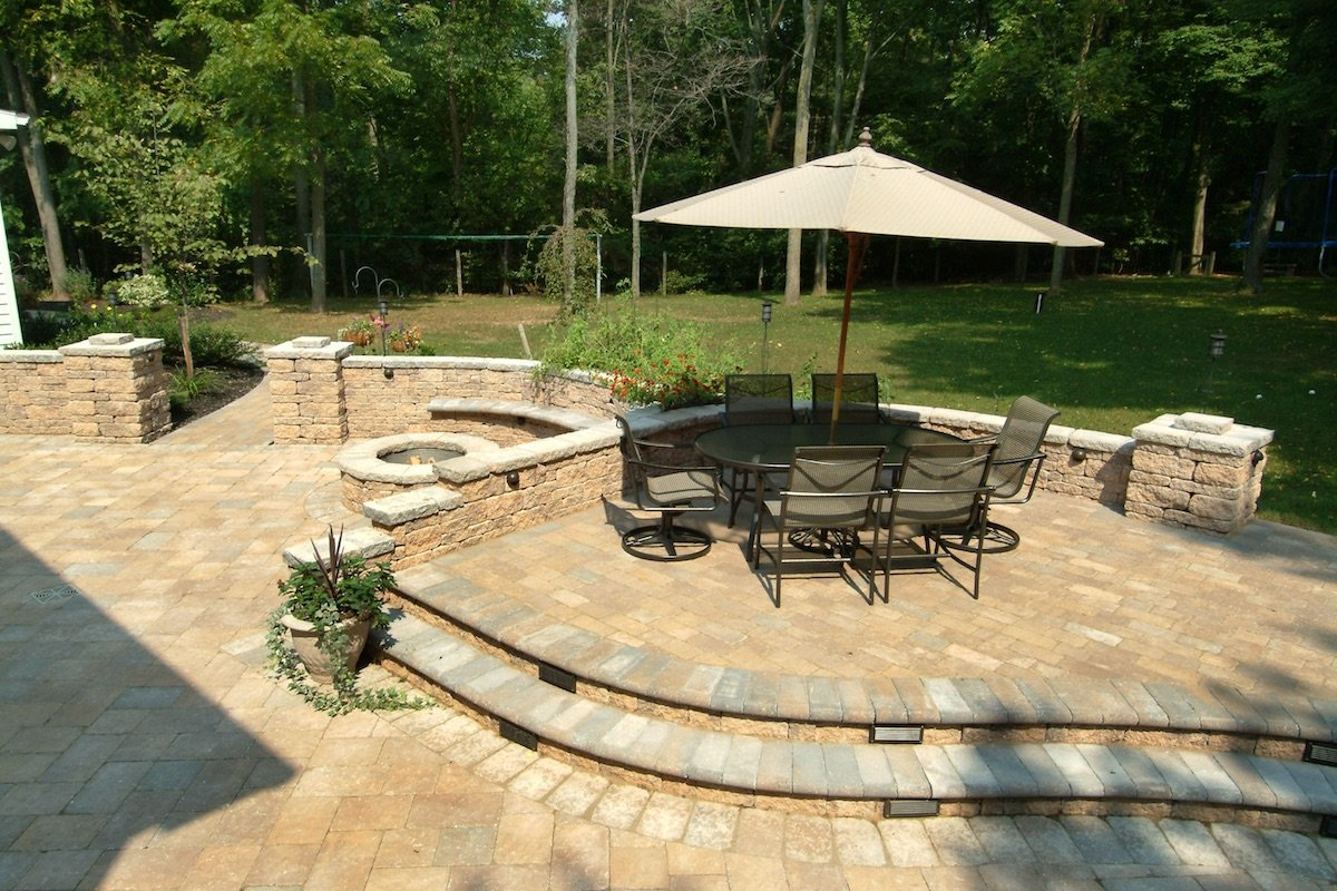 paver patio with seat wall and fire pit