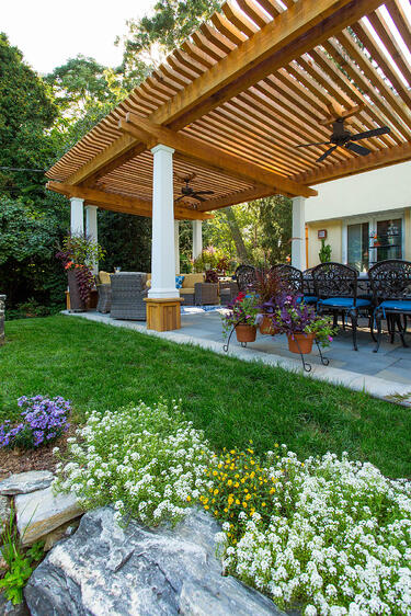 flagstone patio with pergola and plants