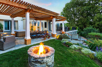 Redesigned landscape in Leola, PA with pergola and fire pit