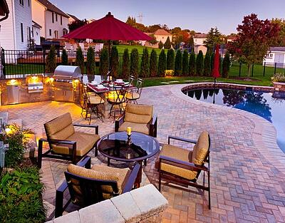 Patio landscape with outdoor kitchen, dining area, and pool