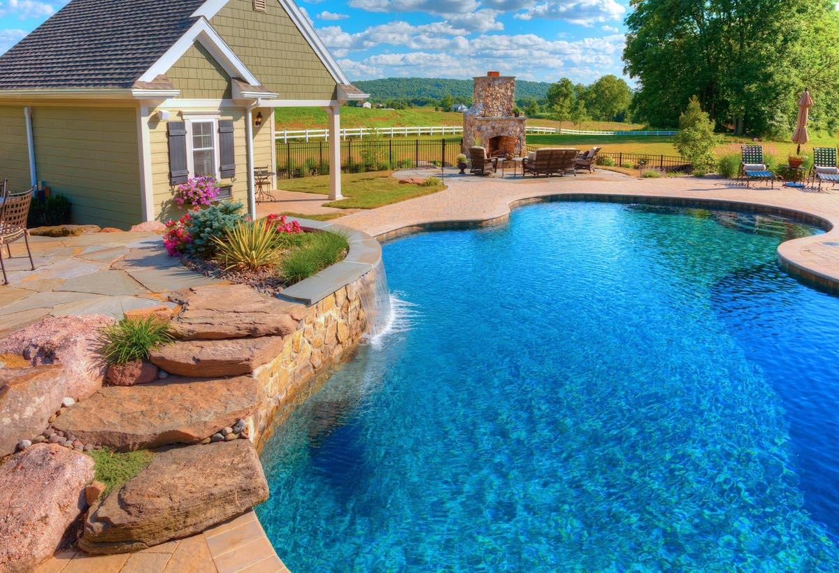 Pool with pool house and outdoor fireplace in Lancaster, PA