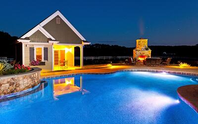 Pool with outdoor fireplace and lighting in Lancaster, PA