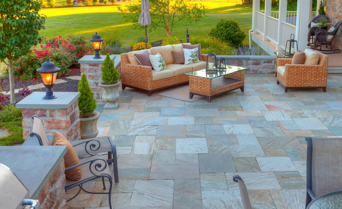 natural stone patio with stone wall