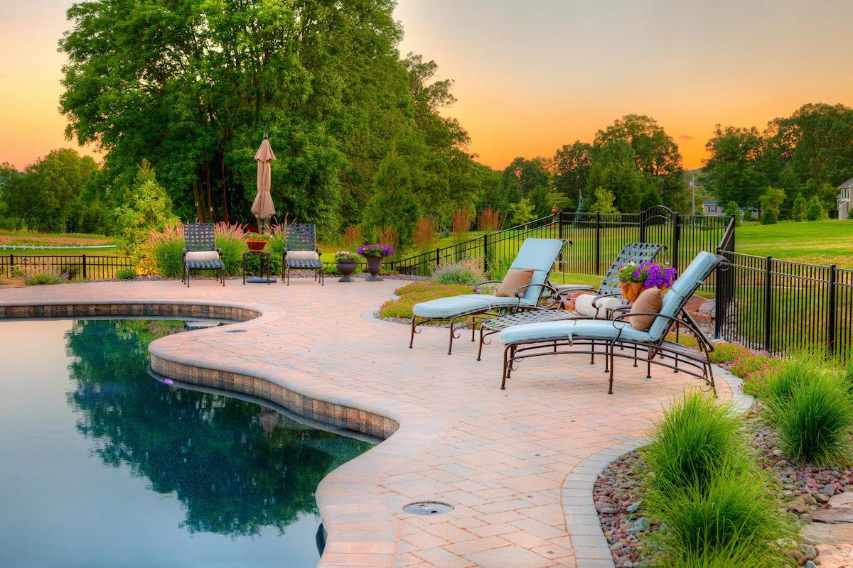 Pool patio with trees and shrubs in Lancaster, PA