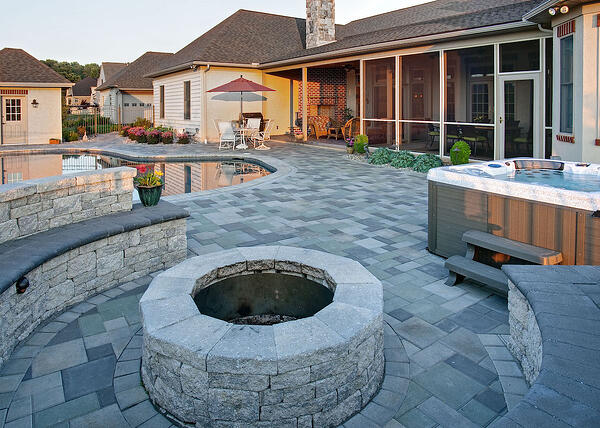 An outdoor fireplace vs. a fire pit? Get tips to answer this landscape design question.