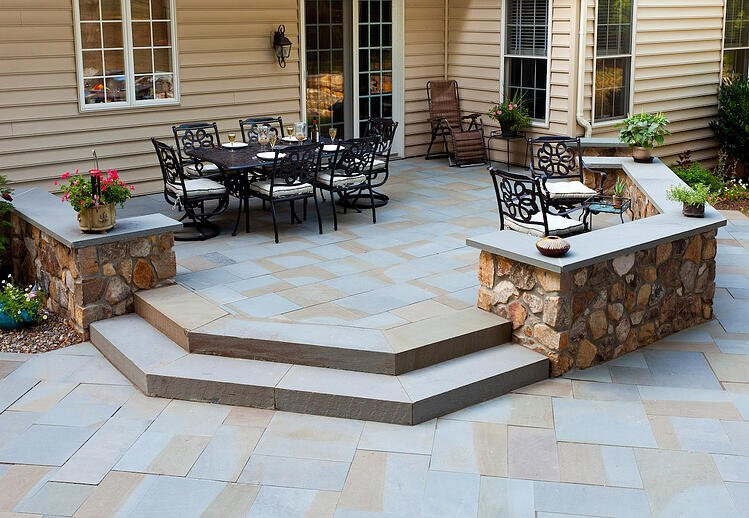 Downingtown PA landscaping project with patio, outdoor kitchen and outdoor fireplace.