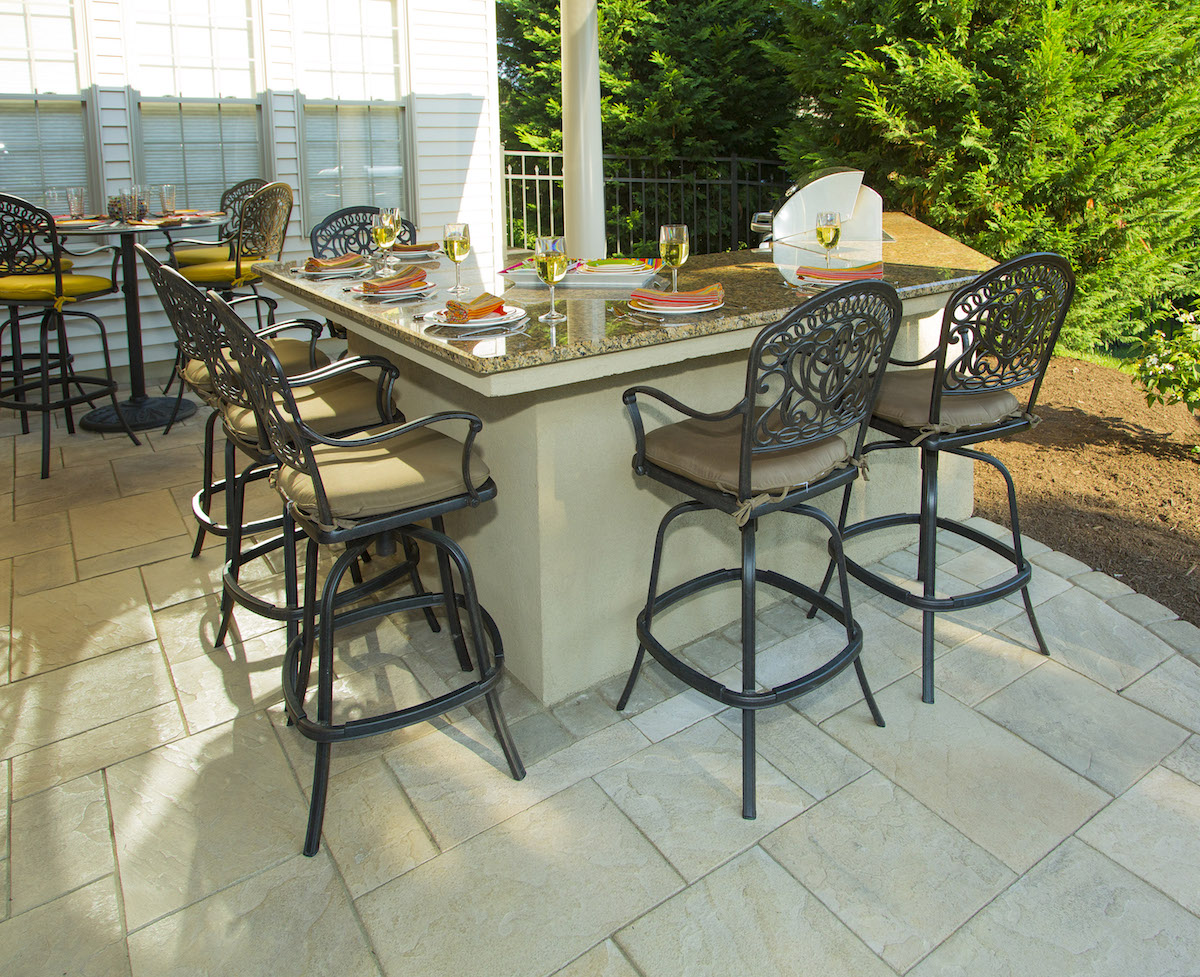 beautiful outdoor kitchen and bar in backyard pavilion