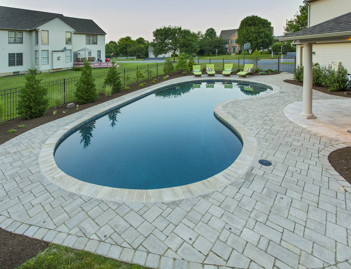 uniquely shaped pool designed by landscaping company in Lancaster, PA