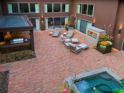 brick patio with outdoor kitchen and spa in Reading, PA