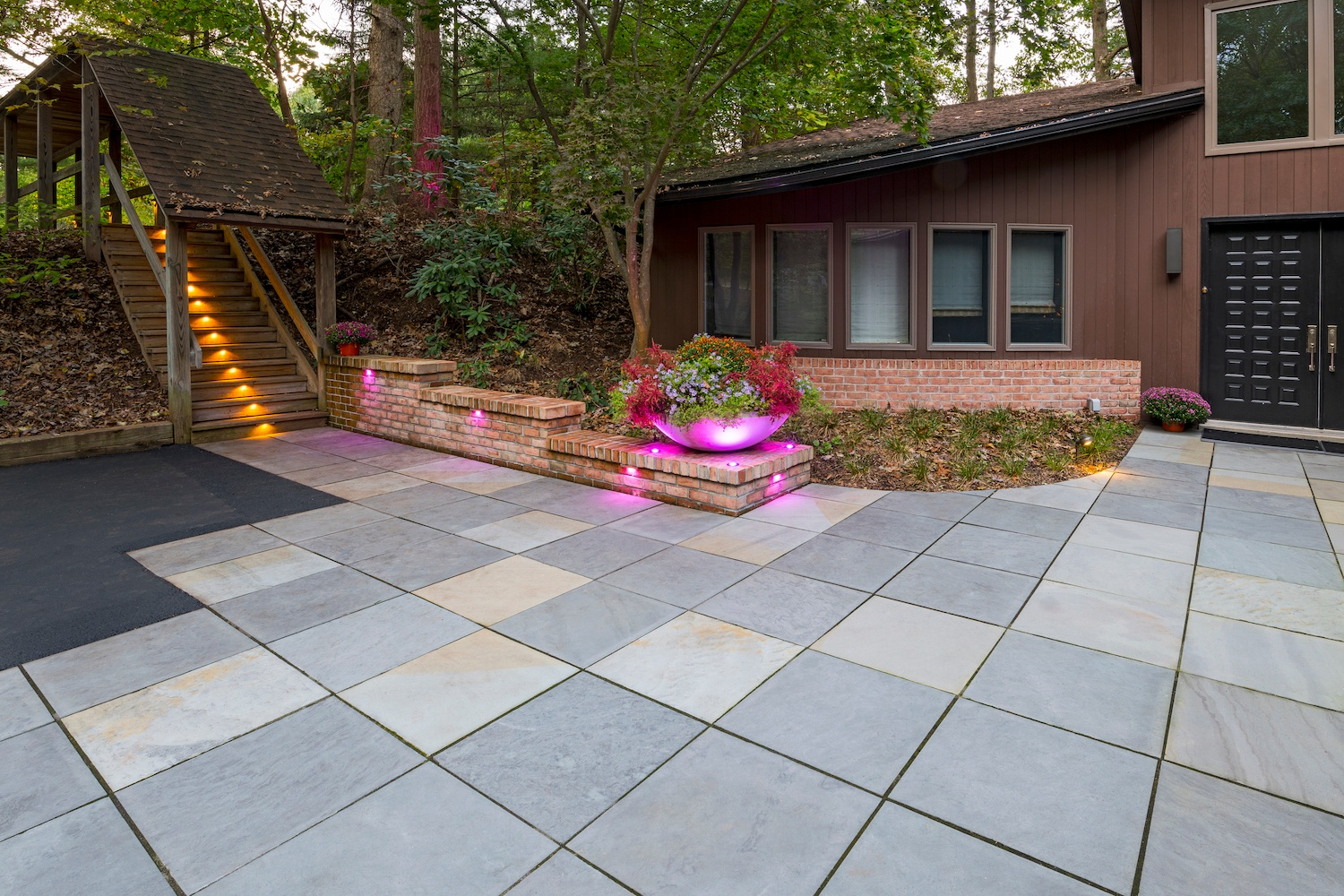 flagstone walkway with brick wall lighting