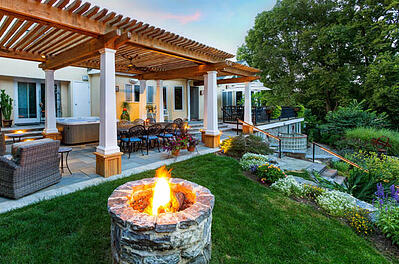 professional landscape design with fire pit pergola and patio