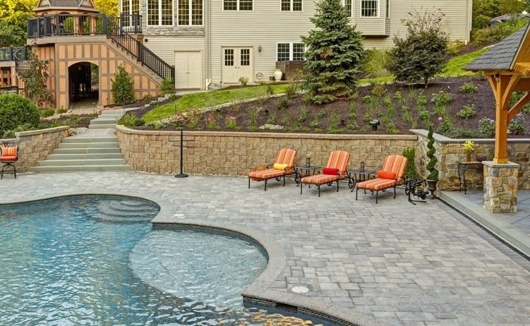 plantings in sloped landscape near pool