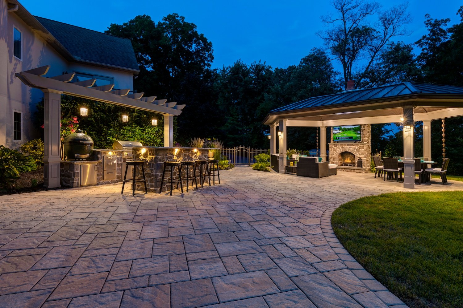 patio, outdoor kitchen, and pavilion with landscape lighting