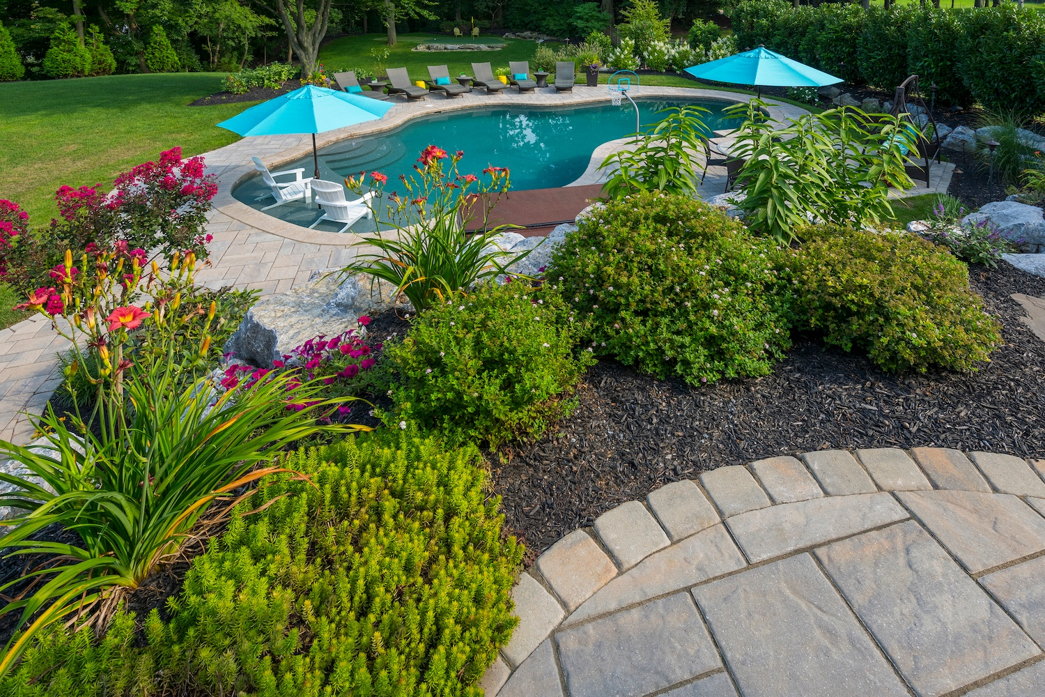 large plant bed near pool