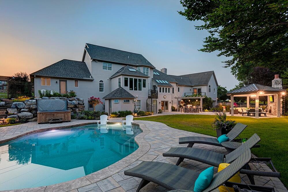 backyard with patio, pool, outdoor kitchen and firplace