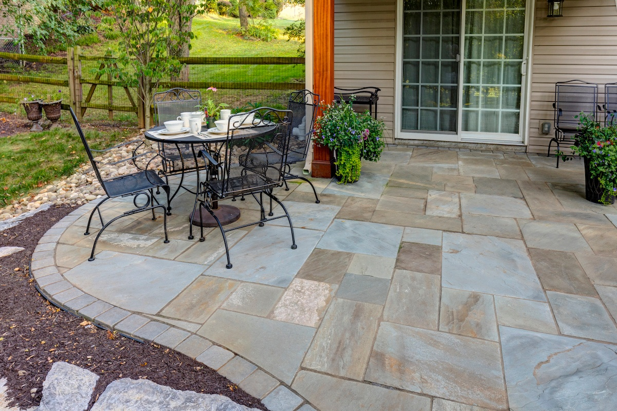 flagstone patio with table and chairs