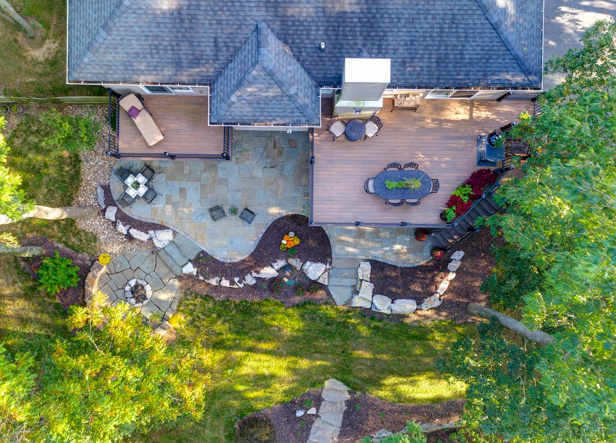 flagstone-patio-aerial-fire-pit-deck