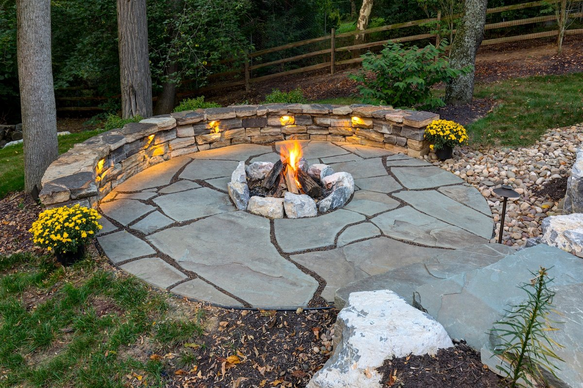 fire pit with wall lighting