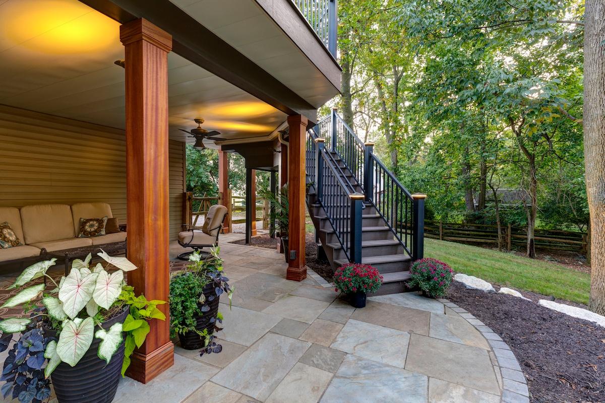 flagstone-patio-lighting-under-deck-stairs-1