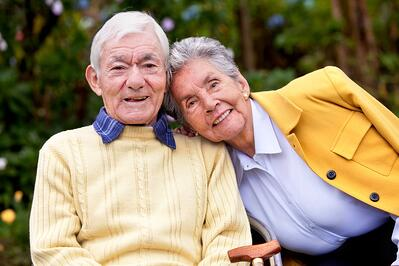 portrait of a loving elderly couple outdoors