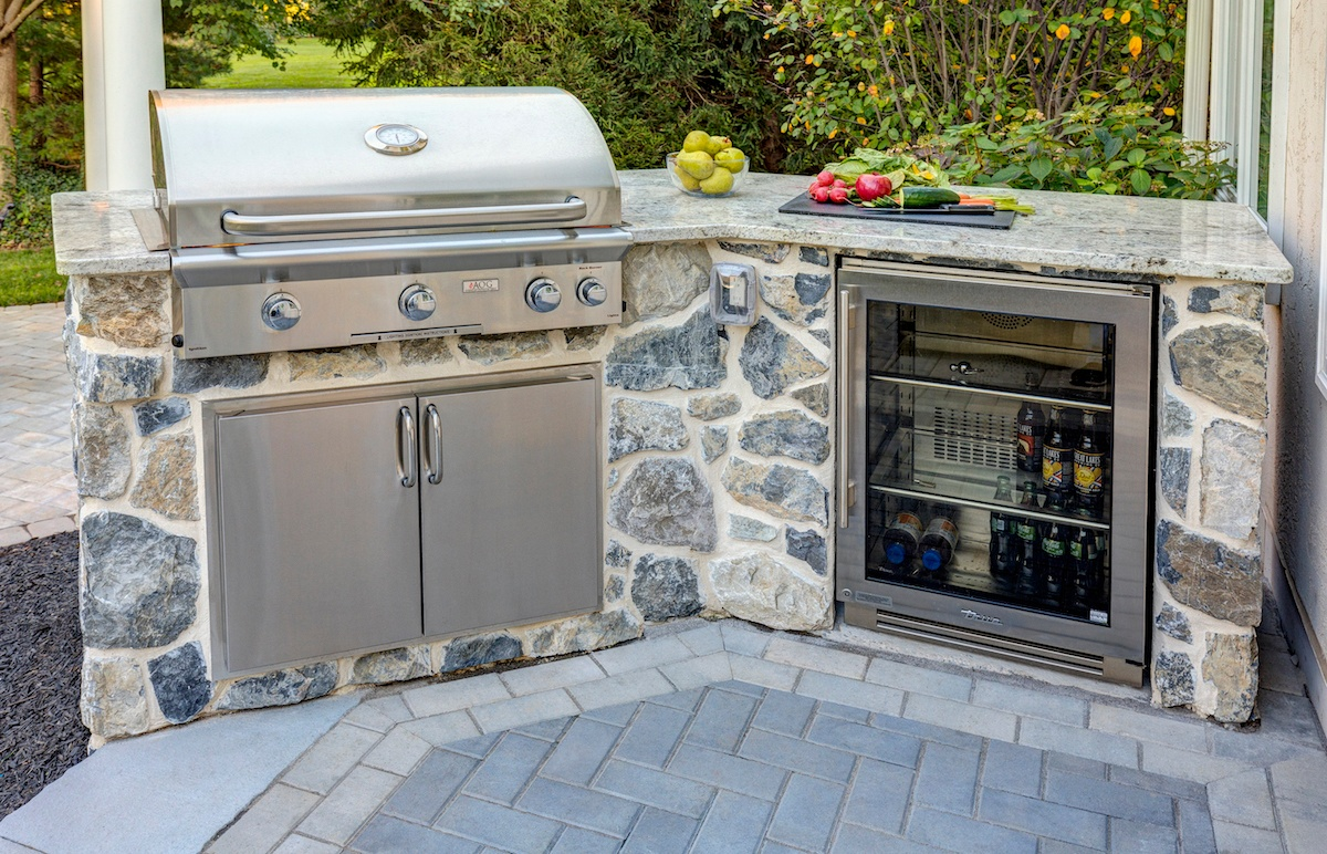 Outdoor kitchen with refrigerator and grill