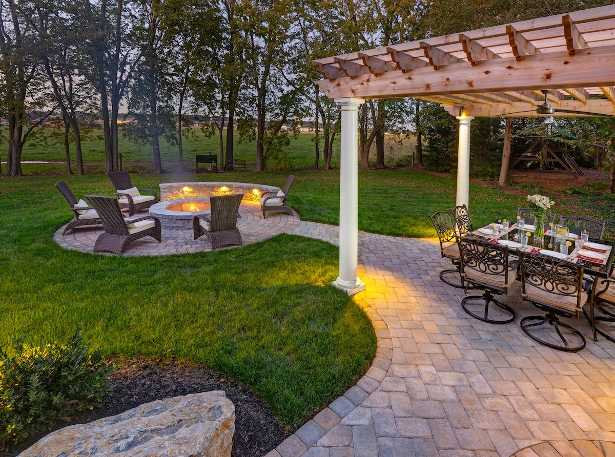 Lititz, PA landscaping after view of fire pit and pergola at dusk