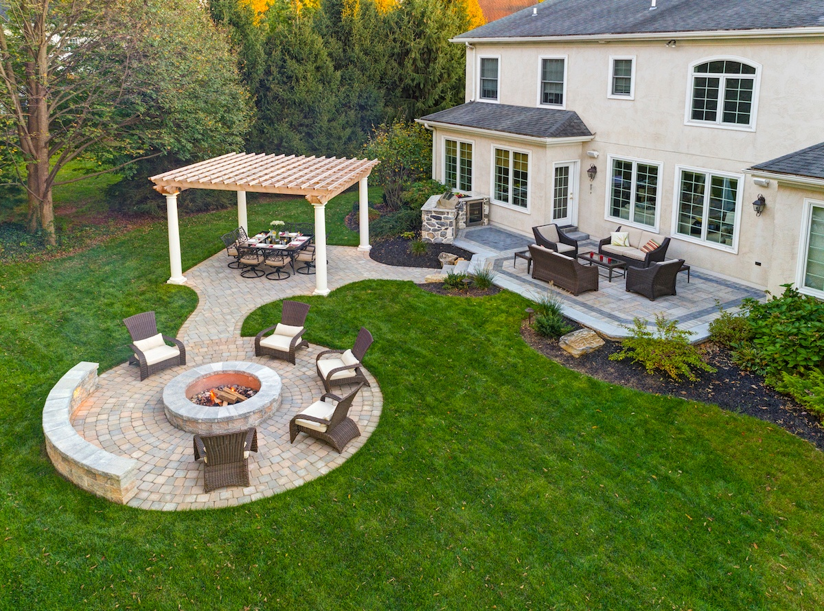 patio with extensions, pergola, and fire pit