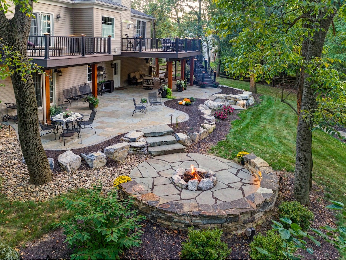 Sloped Backyard Case Study: Under Deck Patio, Fire Pit, Steps & More